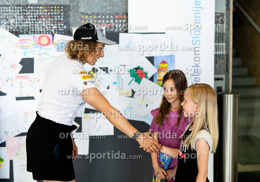 Ilka Stuhec with children after the presentation of new alpine ski team of Ilka Stuhec before new season 2019/20, on June 10, 2019 in Telekom Slovenije, Ljubljana, Slovenia. Photo by Vid Ponikvar / Sportida