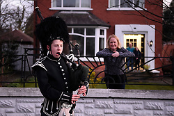 George Orchin (12), a piper in the Campbell College Pipe Band, plays Amazing Grace outside his neighbour's Jill Scott's house in East Belfast, Northern Ireland, during a second Thursday night of 'Clap for our Carers' as people across the country showed their appreciation for all NHS workers who are helping to fight the coronavirus.