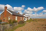 Old fisherman's cottages at Shingle Street, Nr Orford, Suffolk England .<br /> <br /> Visit our ENGLAND PHOTO COLLECTIONS for more photos to download or buy as wall art prints https://funkystock.photoshelter.com/gallery-collection/Pictures-Images-of-England-Photos-of-English-Historic-Landmark-Sites/C0000SnAAiGINuEQ