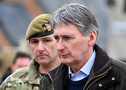 © Licensed to London News Pictures. 09/03/2012. Copedown Hill, UK. Secretary of Defence Philip Hammond pictured with Brigade Commander, Brigadier Doug Chalmers,  visits troops during the day. The 12thMechanized Brigade (12 Mech Bde) at Copehill Down, Salisbury Plain Training Area, Wiltshire,on FRIDAY 09 MARCH 2012, as it prepares to deploy to Helmand Province, Afghanistan, on Operation Herrick 16, in the Spring of this year. The Brigade were performing a dynamic demonstration of combined Afghan/ISAF operations supported by surveillance assets and casualty evacuation capability. Tornado GR4 fast jest ground support was also displayed.. Photo credit : Stephen SImpson/LNP