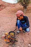 Bedouin man cooking coriander for coffee, Dana Biosphere Reserve, Wadi Feynan, Jordan.