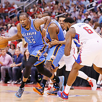 11 May 2014: Oklahoma City Thunder forward Kevin Durant (35) drives past Los Angeles Clippers center DeAndre Jordan (6) during the Los Angeles Clippers 101-99 victory over the Oklahoma City Thunder, during Game Four of the Western Conference Semifinals of the NBA Playoffs, at the Staples Center, Los Angeles, California, USA.