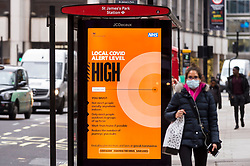 © Licensed to London News Pictures. 30/10/2020. LONDON, UK.A digital screen in Westminster displays the local Covid alert level.  As the number of UK reported positive coronavirus cases continues to rise, the UK government may impose a complete lockdown in the capital.  The city is currently under Covid-19 tier 2 level High.  Photo credit: Stephen Chung/LNP
