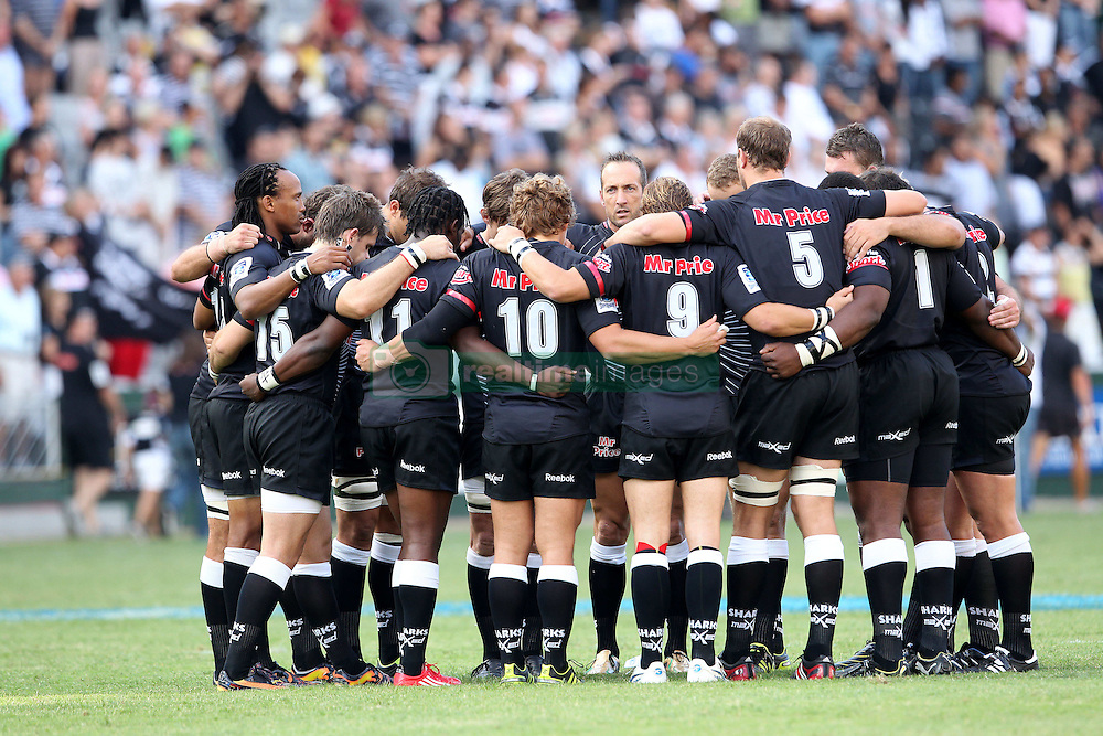 Sharks team huddle during the minutes silence for the earthquake victims in Christchurch, New Zealand during the Super15 match between The Mr Price Sharks and The Blues held at Mr Price Kings Park Stadium in Durban on the 26th February 2011..Photo By:  Ron Gaunt/SPORTZPICS