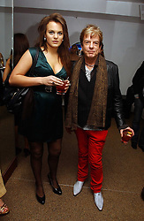 NICKY HASLAM and MOLLY MILLER MUNDY at a party to celebrate the publication of Tatler's Little Black Book 2006 held at 24, 24 Kingley Street, London W1 on 9th November 2006.<br /><br />NON EXCLUSIVE - WORLD RIGHTS MINIMUM PUBLICATION FEE £200.00+VAT