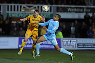 Plymouth's Curtis Nelson ® challenges Newport county's Mike Flynn. Skybet football league two match, Newport county  v Plymouth Argyle at Rodney Parade in Newport, South Wales on Tuesday 8th April 2014.<br /> pic by Andrew Orchard, Andrew Orchard sports photography.