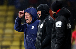 Cardiff City manager Neil Warnock in the rain during the Premier League match at Vicarage Road, Watford.