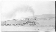 """RGS 2-8-0 #16 with passenger train, possibly near the site of the original roundhouse at MP 0.5.<br /> RGS  Ridgway, CO  ca. 1914<br /> In book """"Southern, The: A Narrow Gauge Odyssey"""" page 120<br /> See RD155-070 for enlargement.<br /> Also in """"RGS Story Vol. I"""", p. 158.<br /> Thanks to Don Bergman for additional information."""