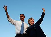 US Democratic presidential nominee Senator Barack Obama (D-IL) and Senator Hillary Clinton (D-NY) wave to the crowd during a campaign rally in Orlando, Florida October 20, 2008. REUTERS/Jim Young