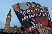 As the British government debated US President Donald Trumps state visit to the UK, thousands of protesters gathered in large numbers against the trip which would potentially cost millions of Pounds in security alone, on 20th February 2017, in Parliament Square, London, UK. The visit comes after two online petitions received more than the 100,000 signatures required for such a debate to be considered in Parliament. A petition against the state visit got 1.85m signatures, while one supporting it got 311,000. Campaigners protested against the hatred, racism and division that Donald Trump is trying to create. Prime Minister Theresa May announced the state visit during her visit to Washington in January.