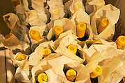 Bottles of Pisano wine wrapped in paper and with yellow capsules. Bodega Pisano Winery, Progreso, Uruguay, South America