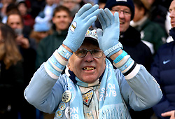"""Manchester City Super fan """"Pete The Badge"""" in the stands prior to the beginning of the match"""