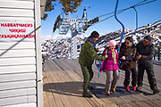 A mother and daugther board the two man chairlift at Beldersay ski resort on 27th February 2014 in Uzbekistan.