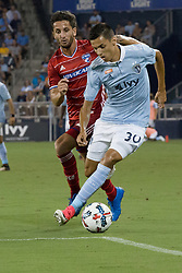 August 19, 2017 - Kansas City, Kansas, U.S - Sequence 13-03: Sporting KC forward Daniel Salloi #30 (right) gains the offense against FC Dallas defender Hernan Grana #2 (left) during the second half of the game. (Credit Image: © Serena S.Y. Hsu via ZUMA Wire)