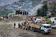 Residents and emergency workers lifting out posessions with ropes, in the rubble of a landslide. A major lansdlide in La Paz in 2011 made around 25,000 people homeless, due to heavy rain and poor infrastructure, there were no fatalities and only minor injuries sustained