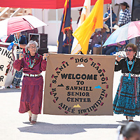 Pauline M. Begay, left, and Mary Barbone, right, hold a banner for the Sawmill Senior Center as they participate in a banner contest at the Annie Wauneka Arena Thursday, Sept. 5 as part of the Senior Day activities at the Navajo Nation Fair in Window Rock.