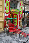 A rickshaw stands outside a Thai Massage business in central prague, on 18th March, 2018, in Prague, the Czech Republic. Known for its cheap beer for stag and hen parties male and female pre-wedding drinking weekends, their is plenty to help foreigh visitors to ease the alcohol-fuelled visits to the Czech capital.