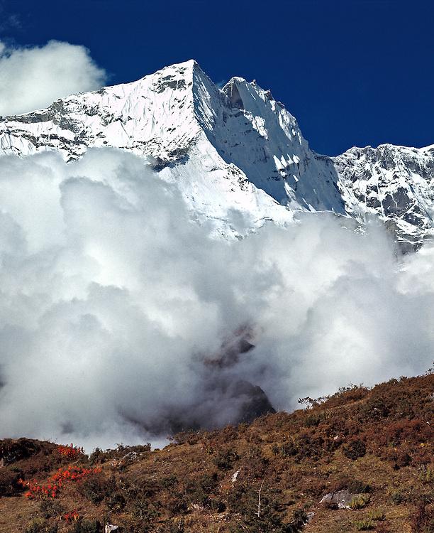 Clouds collect around Kwangde Peak in the Khumbu Himalaya in Sagarmatha National Park, Nepal.