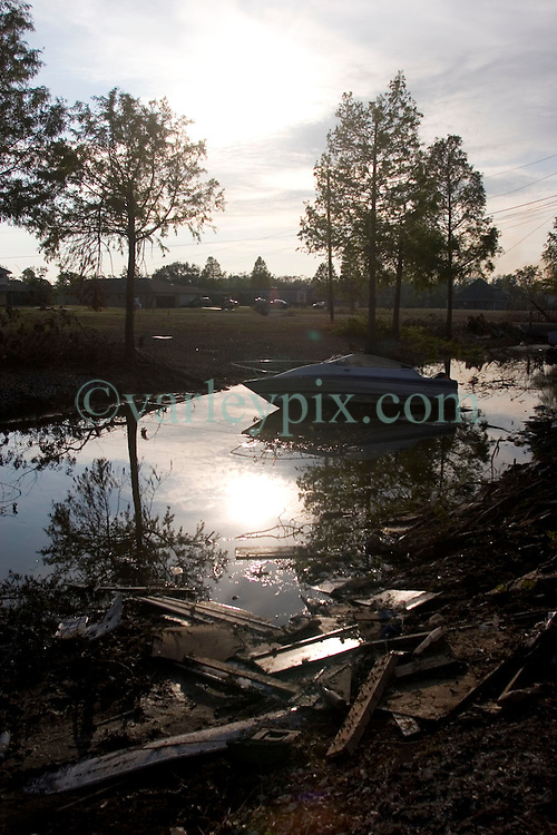 03 November, 2005.  New Orleans, Louisiana. Post Katrina.<br /> A boat lies askew in a trash filled drainage ditch in Saint Bernard parish. Hurricane Katrina caused a 20ft tidal surge to sweep over the land, devastating much of the parish.<br /> Photo; ©Charlie Varley/varleypix.com