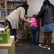 Aliyah Randle (center) is comforted by her mom, Laurell Florence (right) and her case manager, Nancy DeMoss, December 19, 2015, while having an asthma attack at the Child Crisis Center, Mesa, Arizona. Laurell visited often, she was trying to piece her life together, so she could get her daughter back.