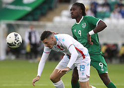 Luxembourg's Edin Osmanovic (left) and Republic of Ireland's Joshua Ogunfaolu-Kayode battle for the ball during the UEFA Under-21 Championship Qualifying Round Group F match at the Tallaght Stadium, Dublin. Picture date: Friday October 8, 2021.