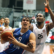 Besiktas integral Forex's Hilton Armstrong (R) and Anadolu Efes's Dario Saric (L) during their Turkish basketball league match Besiktas integral Forex between Anadolu Efes at BJK Akatlar Arena in Istanbul, Turkey, Monday, January 05, 2015. Photo by TURKPIX