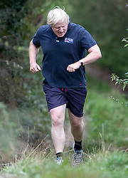 © Licensed to London News Pictures. 11/09/2018. Thame, UK. Boris Johnson check his watch as he returns from a morning run at his Oxfordshire house . Last week it was announced that Boris Johnson and his wife Marina Wheeler are getting divorced. Photo credit: Peter Macdiarmid/LNP