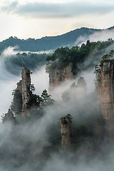 Mountains in the mist, Wulingyuan National Park, Hunan, China: this UNESCO World Heritage Site is noted for more than 3,000 sandstone pillars and peaks many over 200 metres (660 ft) in height. It was the inspiration for the Hallelujah Floating Mountains of Pandora in the block buster film Avatar. <br /> <br /> The trick to photographing these pillars is to capture them during or after a rain when the super moist air creates a fog condition. I photographed these mountains four times in four different seasons and only saw the fog twice and for a fleeting less than an hour time frame. Without fog, in my opinion there is no picture. <br /> <br /> BIO: Sony Ambassador Michael Yamashita has shot for National Geographic for more than 30 years, combining his passions of travel and photography with his love of history and culture. An Asian Studies major at Wesleyan University and fluent in Japanese, Michael followed his roots to become a Far East expert. In addition to his work throughout Asia, which has included intensive concentrations in China, Japan, Korea, and India, his assignments have taken him to six continents.<br /> <br /> Michael's specialty has been in retracing the journeys of iconic explorers, such as Marco Polo and the Chinese admiral Zheng He, along their historic routes to illuminate the legacy of the Silk Road and to help us understand China's sweeping The Belt and Road Initiative (BRI).<br /> <br /> Michael has won a host of industry awards, including those from the prestigious Pictures of the Year competition, Photo District News, the New York Art Directors Club, and the Asian American Journalists Association. His most recent exhibits are in Singapore, Hong Kong, Taiwan, Japan, Italy, Germany, and closer to home, at The Carter Center, LACMA, and the Smithsonian National Gallery of Art. Along with two documentary feature films, Yamashita has published 16 books in multiple languages, including his latest, the Silk Road Journey.<br /> <br /> WEBSITE: michae