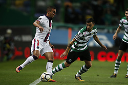 October 22, 2017 - Lisbon, Portugal - Sporting's midfielder Bruno Fernandes  (R) vies for the ball with Chaves's forward Tiago Galvao (L)  during Primeira Liga 2017/18 match between Sporting CP vs GD Chaves, in Lisbon, on October 22, 2017. (Credit Image: © Carlos Palma/NurPhoto via ZUMA Press)