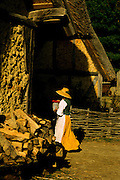 Image of a woman carrying water at Jamestown Settlement, Virginia, east coast by Randy Wells