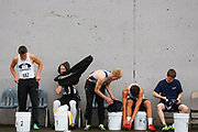 Genna Martin / The Herald<br /> The Men's 110 meter hurdle competitors put their sweats back on after the race during Saturday's Eason Invitational. <br /> Photo taken 04132013