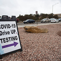 Cars line up on Gurley Avenue on the campus of the University of New Mexico-Gallup during Gallup Indian Medical Center's COVID-19 vaccination event Saturday morning.