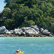Couple on kayak In Ko Lipe, Thailand