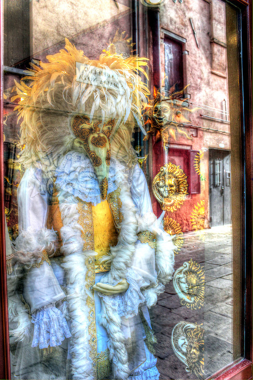 Street reflections in shop window selling Venetian Masks and costumes, Venice, Italy