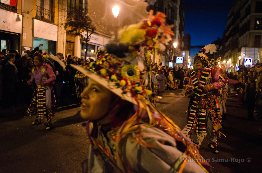 Dancers with traditional dresses from Bolivia dancing at Madrid's carnival parade.