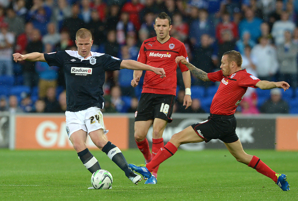 Huddersfield Town's Keith Southern is put under pressure by Cardiff City's Craig Bellamy ..Football - npower Football League Championship - Cardiff City v Huddersfield Town - Friday 17th August 2012 - Cardiff City Stadium - Cardiff..