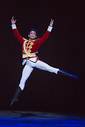 """© Licensed to London News Pictures. 10/12/2013. London, England. Picture: Yonah Acosta as the Prince. Final working stage rehearsal of """"Nutcracker"""" at the London Coliseum. Choreography by Wayne Ealing with music by Pyotr Ilyich Tchaikovsky. Photo credit: Bettina Strenske/LNP"""