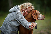 SHOT 8/4/14 9:02:35 AM - Alyssa O'Connell, 9, of Albuquerque, N.M. hugs Tanner, a male Vizsla belonging to her uncle, during a camping trip in Granite, Co. The San Isabel National Forest is located in central Colorado. The forest contains 19 of the state's 54 fourteeners, peaks over 14,000 feet high, including Mount Elbert, the highest point in Colorado.<br /> (Photo by Marc Piscotty / © 2014)