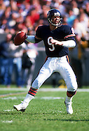CHICAGO,IL-1988:  NFL quarterback Jim McMahon of the Chicago Bears drops back to pass during an NFL game at Soldier Field in Chicago Illinois.  McMahon played for the Chicago Bears from 1982-1988.  (Photo by Ron Vesely)