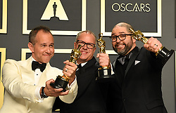 Josh Cooley, Mark Nielsen and Jonas Rivera with their Best Animated Feature Film Oscar for Toy Story 4 in the press room at the 92nd Academy Awards held at the Dolby Theatre in Hollywood, Los Angeles, USA.