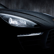 Porsche Macan bonnet side profile with rain splashing down onto it and light on Ray Massey is an established, award winning, UK professional  photographer, shooting creative advertising and editorial images from his stunning studio in a converted church in Camden Town, London NW1. Ray Massey specialises in drinks and liquids, still life and hands, product, gymnastics, special effects (sfx) and location photography. He is particularly known for dynamic high speed action shots of pours, bubbles, splashes and explosions in beers, champagnes, sodas, cocktails and beverages of all descriptions, as well as perfumes, paint, ink, water – even ice! Ray Massey works throughout the world with advertising agencies, designers, design groups, PR companies and directly with clients. He regularly manages the entire creative process, including post-production composition, manipulation and retouching, working with his team of retouchers to produce final images ready for publication.