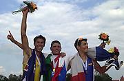 Trakai, LITHUANIA.  centre,  ITA JM1X Gold Medalist, Frederico Gattinoni,  left, AUS JM1X  Silver medalist  Eugene Arendsen and right   FRA JM1X  Bronze medalist, Cedric Berrest . 2002 Junior World Rowing Championships, on Lake Galva Wednesday  07/08/2002 [Mandatory Credit: Peter Spurrier/ Intersport Images] 200208 Junior World Rowing Championships, Trakai, LITHUANIA