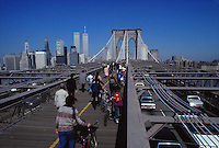 Pedestrians walking into Manhattan on the Brooklyn Bridge, pre- 911,showing the twin towers of the World Trade Center
