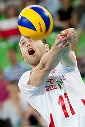 Fabian Drzyzga #11 of Poland during volleyball match between National teams of Slovenia and Poland in 4th Qualification game of CEV European Championship 2015 on May 23, 2014 in Arena Stozice, Ljubljana, Slovenia. Photo by Urban Urbanc / Sportida