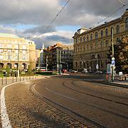 Prague street of bricks with tram lines going to bridge near Jan Pallach Square