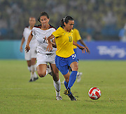 Beijing, CHINA, Olympic Football, Women's Gold  Medal Game, USA vs BRA, Brazils MARTA on the ball. with USA  No.7. Shannon BOXX. chasing her down,  iduring the first half of the final at the Beijing Workers Stadium. Thursday,  21.08.2008 [Mandatory Credit: Peter SPURRIER, Intersport Images]