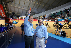 Robert Miller, chief executive officer for Phynova fires the starter's pistol for the Men's Team Elimination during day two of the Six Day Series Manchester at the HSBC UK National Cycling Centre.