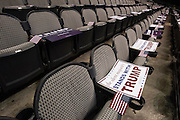 Signs rest on seats before presidential candidate Donald Trump speaks during a rally at the American Airlines Center in Dallas, Texas on September 14, 2015. (Cooper Neill for The New York Times)