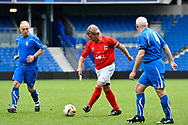 Spencer Pratten (Captain) of England over 60's on the attack during the world's first Walking Football International match between England and Italy at the American Express Community Stadium, Brighton and Hove, England on 13 May 2018. Picture by Graham Hunt.