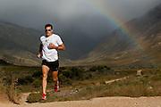 Dan Hugo on a training run in Jonkershoek, Stellenbosch. Multi-sport champion running through his scenic neighbourhood. Image by Greg Beadle, Jawbone eyewear by Oakley Portraits captured by Greg Beadle in studio and on location
